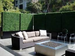 Outdoor Patio Windscreen by Create Privacy On A Patio Or Balcony With Tall Faux Hedges