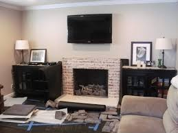 installing veneer stone and hearth over old white brick fireplace