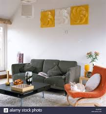 Modern Gray Sofa by Plastic Wall Art Above Gray Sofa In Modern Living Room With Black