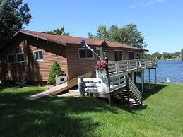 spacious waterfront log home on upper silver lake mears michigan