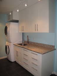 white stained wooden laundry room floating cabinet storage
