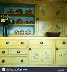 Pale Yellow Kitchen Cabinets Floral Painted Doors On Pale Yellow Fitted Cupboards In Cottage