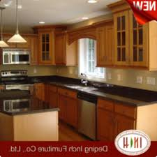 kitchen with two islands with black cabinets and main white