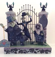 jim shore halloween figurines amazon com disney haunted mansion hitchhiking ghosts figurine