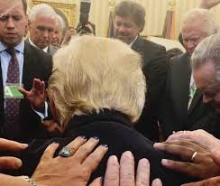 photo surfaces of evangelical pastors laying hands on trump in the