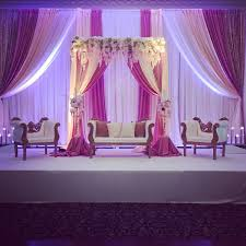 wedding backdrop reception blush pink reception backdrop with florals indian wedding stage