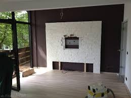 steinwand wohnzimmer tv haus renovierung mit modernem innenarchitektur ehrfürchtiges