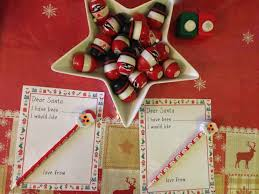 santa writing paper letters to santa with free template here come the girls to get them started i made some special writing paper decorated with christmas presents the twins are three and i thought they need a bit more scaffolding