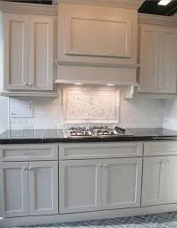 grey kitchen cabinets and black countertops rethinking white kitchen cabinets trendy kitchen tile