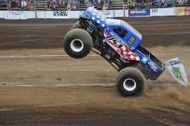 monster trucks racing in mud trucks in action gts fiberglass u0026 design