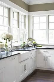 white sink black countertop kitchen designed with white cabinets and porcelain kitchen sink with