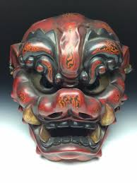 devil mask for halloween japanese demon oni mask made out of wood and red and brown