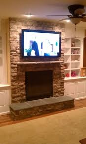 stone fireplace with tv over fireplace tv installation stone