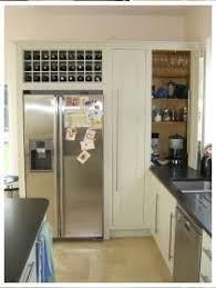 bespoke wine rack above large fridge freezer for the home