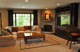 family room design with tv over fireplace warm family room