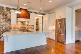 how to hang kitchen cabinets on brick wall exposed brick walls transitional kitchen jacksonbuilt