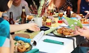 family gathering on decorate dinner table in how to decorate a
