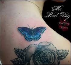 wonderful butterfly with rose tattoo on right back shoulder