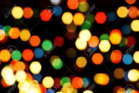 multi colored tree lights bokeh and sparkles stock photo