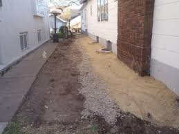 patio drainage problem french drain installation exterior drain tile