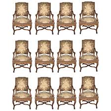 set of 12 louis xv style dining chairs with tapestry upholstery