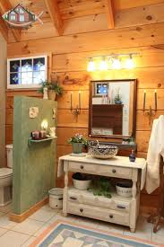 20 best log homes with color images on pinterest log homes log master bathroom with antique furniture and two stained glass windows opposite each other