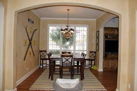 linear chandelier dining room dining room with brick background