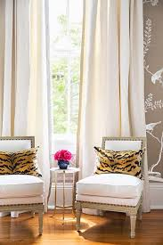 bedroom sitting chairs slipper chairs with tiger print pillows and gray key