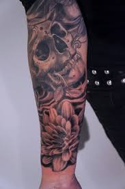 skull and flower sleeve tattoo by graynd tattoos pinterest