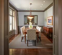 upholstered chairs dining room traditional with gray crown molding