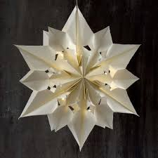 a large and shining star made from paper bags christmas