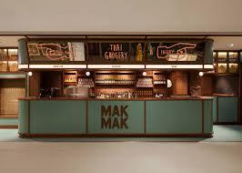 mak modern asian kitchen nc design u0026 architecture hides restaurant behind grocery stall
