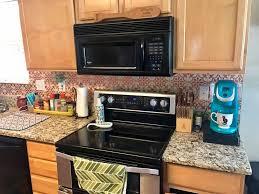 copper kitchen backsplash a metallic tile stenciled kitchen backsplash stencil stories