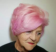 hairstyles for women over 50 with round faces growing out a pixie cut for women with round face