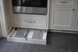 folding step stool in kitchen traditional with waypoint cabinets