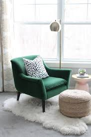 green reading chair with chrome floor lamp and small egg ottoman