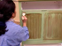 how to paint unfinished cabinets how to antique a cabinet how tos diy