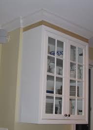 Molding Kitchen Cabinet Doors How To Add Crown Molding Cabinet Doors Imanisr Com