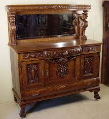 highly carved oak sideboard with standing griffins