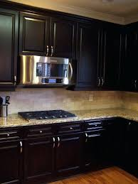 painting stained kitchen cabinets painting vs staining kitchen cabinets faced