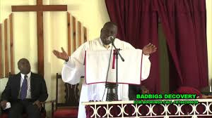 pastor sheldon givans at a service thanksgiving preaching at free