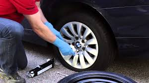 changing a flat tire on a bmw or mini bavauto space saver spare