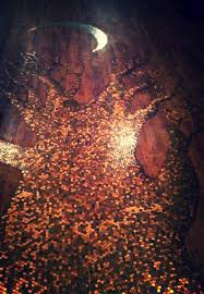 a tree made of 24 000 pennies on the floor of a local coffee shop