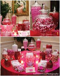 wedding candy table i like the different sizes of vases makes it look fancy and with