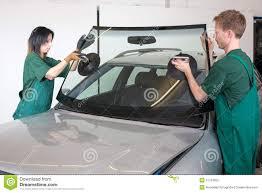 glazier replacing windshield stock photo image 31753900