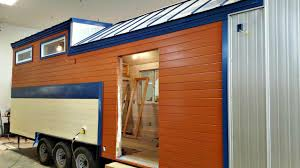 Modern Solar Powered Tiny House With Crisp White Walls  Bamboo - Solar powered home designs