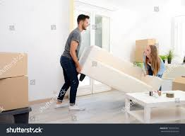 happy young couple student roommate packing stock photo 702013744