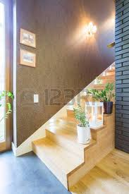 interior of a house hallway with solid wood staircase stock photo