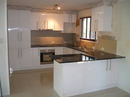 kitchen cabinets white shaker cabinets with black counters small