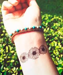 best 25 flower wrist tattoos ideas on pinterest henna tattoo